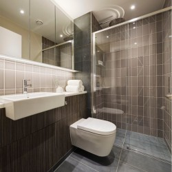 shower room with sink, mirror cabinets, shower cubicle.