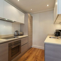 kitchen with oven, cooking hob, microwave, fridge, freezer and sink