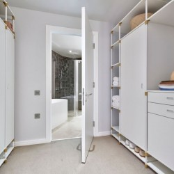 walk-in with wardrobe room with entrance to bathroom