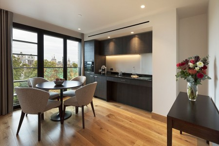 1 bedroom apartment with dining table and kitchen
