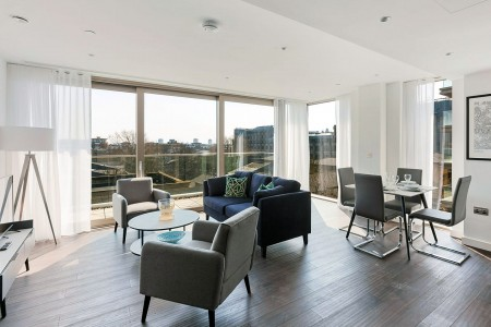 spacious living room with floor to ceiling windows